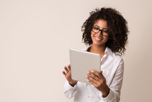 Happy Businesswoman Using Tablet Over Light Background