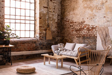 Pouf And Wooden Table On Carpet Near Window In Wabi Sabi Interior With Sofa And Armchair. Real Photo