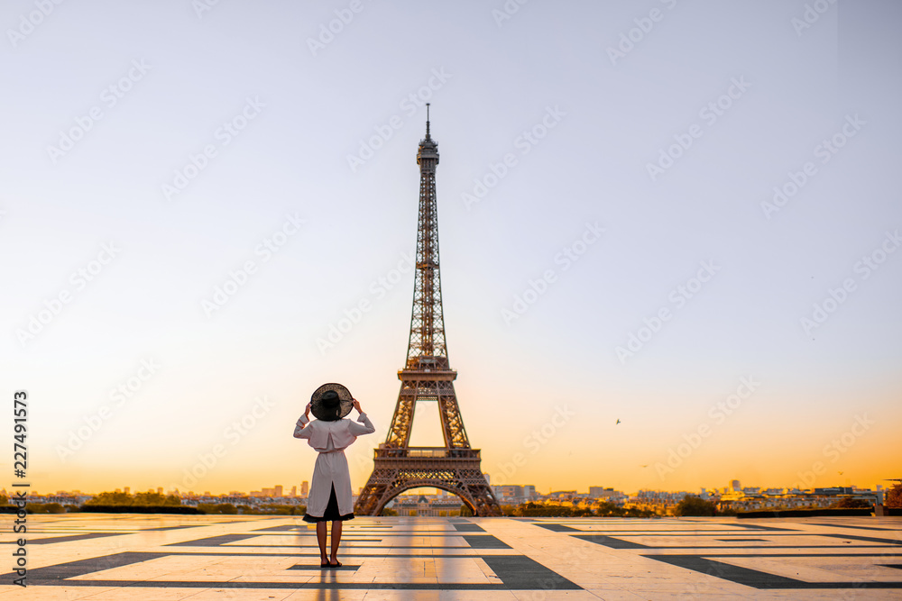 Fototapeta Famous square with great view on the Eiffel tower and woman standing back enjoying the view in Paris