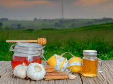 Fresh Honey, Lemon, Garlic, Cinnamon , And Measuring Tape In The Morning On Green Nature Background