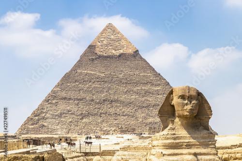 Egypt Spinx face on the Giza pyramid background, Cairo, Egypt