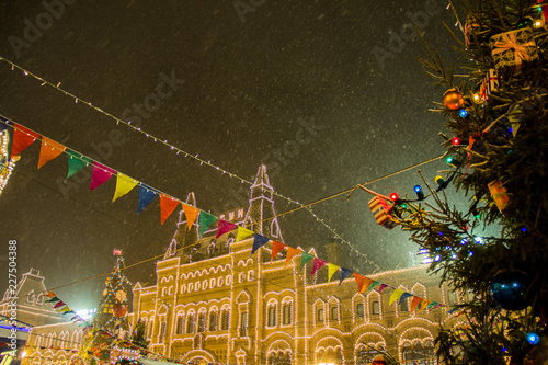 MOSCOW, RUSSIA - DECEMBER 06, 2017: Christmas decorations on a facade, big xmas tree with balls and presents, city night illumination. New Year in Moscow, ...