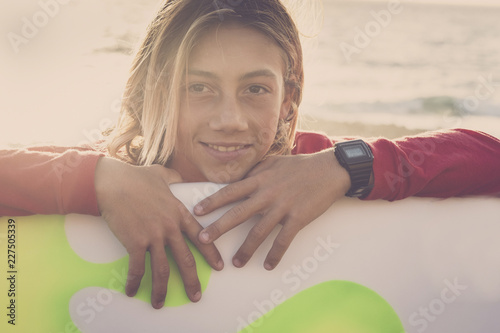 Keuken foto achterwand Ontspanning Handsome caucasian young boy smile and wnjoy the summer life style season. surfer and sporty lifestyle for happy millennial people in outdoor leisure activity