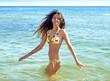 Charming girl having fun on the seashore. girl in summer swimsuit at sea