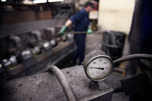 Close Up Of Pressure Gauge On Machinery In Factory