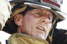 Close Up Of Exhausted Firefighter