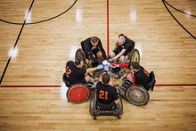 High Angle View Of Disabled Basketball Players Touching Ball