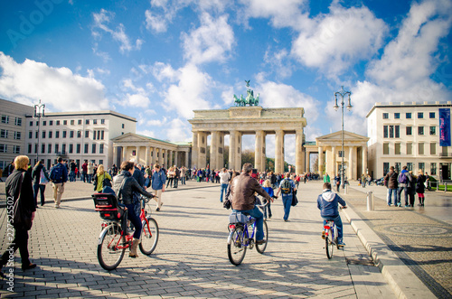 People cycling near Brandenburg Gate, Berlin, Germany Canvas Print