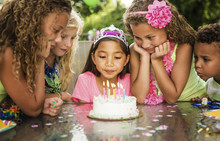 Children Looking At Birthday C...