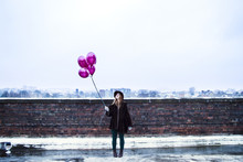 Woman Holding Pink Balloons On...