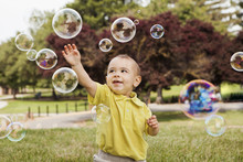 Boy Playing With Soap Bubbles ...