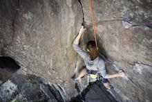 High Angle View Of Woman Climb...