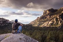 Hiker Sitting On Rock And Looking At Mountains, Prescott, Arizona, USA
