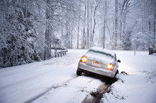 Car Stuck In Snow Covered Road...
