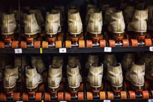 Rows Of Roller Skates On Shelves