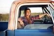 Portrait of woman sitting in pick-up truck