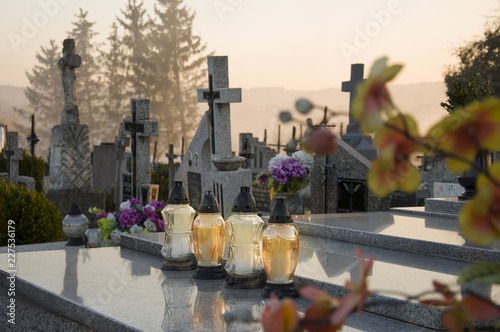 Photographie Gravelights on the grave on All Saints' Day