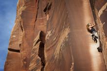 Low Angle View Of Woman Climbi...
