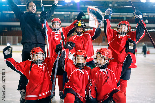 portrait of happy boys players team ice hockey .