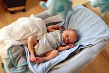 Newborn Boy Sleeping In Bounce...