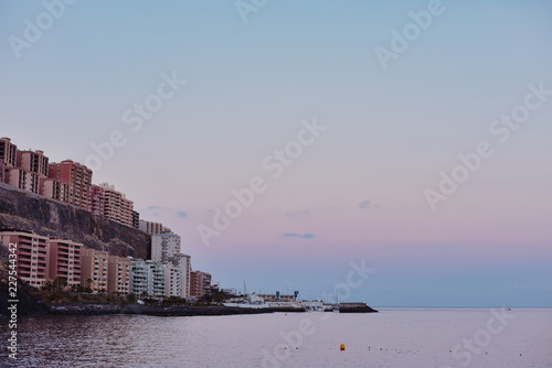 Foto op Canvas Kust Houses and coast in evening