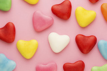 Various Heart-shaped Candy On A Pink Background