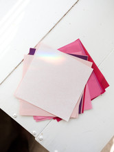 Origami Paper On A Desk With A Rainbow