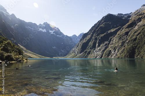 Tuinposter Bergen Woman Swimming in an Alpine Lake