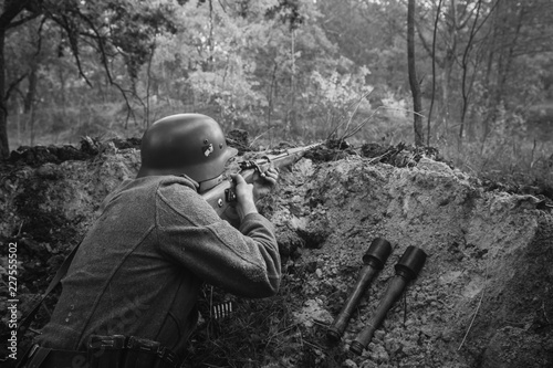 German Wehrmacht Infantry Soldier In World War II Hidden Sitting Wallpaper Mural