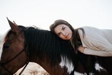 Close-up Of Girl Laying On Horse