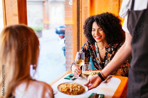Foto op Plexiglas Restaurant Happy female friends dining at restaurant.