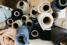 Rolls Of Fabric Stacked Together