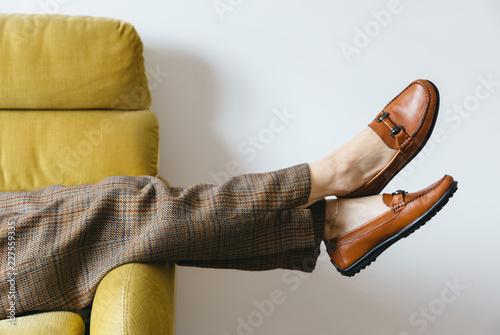 Keuken foto achterwand Retro Female wearing wool pants resting on vintage yellow sofa