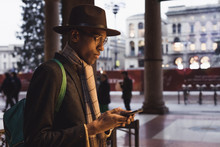 Fashionable Man Using Mobile Phone In The City