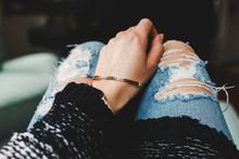 """Woman Wearing A Bracelet That Reads """"""""enjoy The Journey"""""""""""