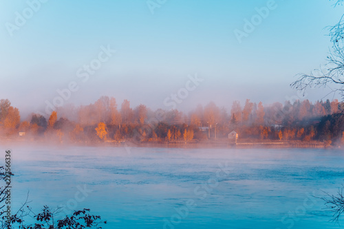 Wall Murals Blue Landscape view on autumn forest lake and morning fog
