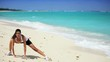 Healthy Female Doing Stretches on the Beach