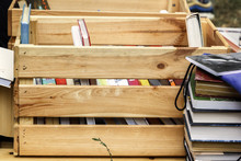 Books In A Wooden Box Are Prepared For Sale At A Street Fair. Close-up