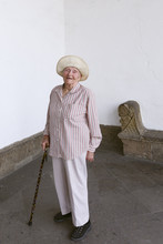 Senior Woman Smiling With Cane...