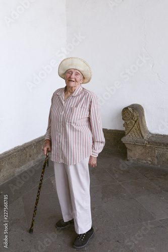 Senior woman smiling with cane and sunhat in Guadalajara, Mexico