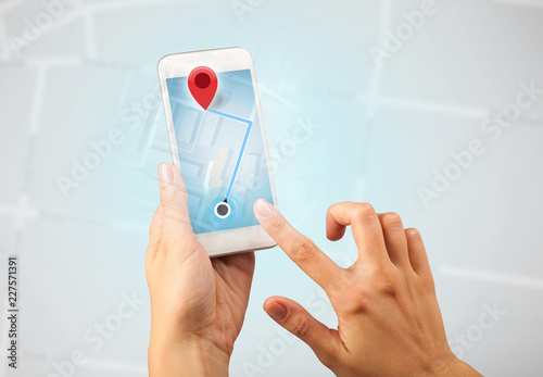 Fotografia  Female fingers touching smartphone with map