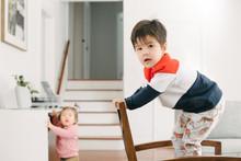 Kid Climbing On Furniture