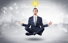 Businessman Meditates With Enl...
