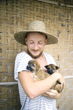 Charming Man  With Adorable Puppies
