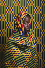 Young Woman Wearing A Colorful Cloth As The Background