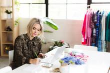 Vintage Fashion Shop Owner In Her Studio.
