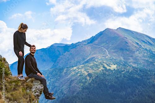 Fototapeta The happy couple enjoying on the beautiful cliff obraz na płótnie