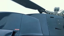 View Looking Up At The Upper Section Of A Helicopter, Tail Rotor And Main Rotors Spinning