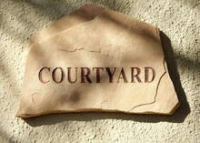 Courtyard Sign At Luxury Resor...