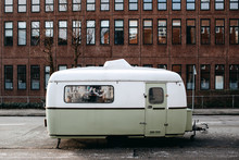 Parked Oldfashioned Camper-trailer On House
